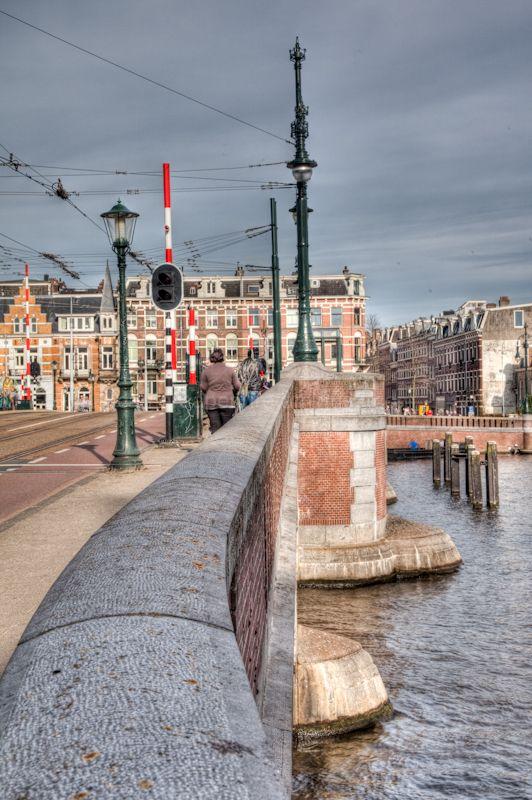 Along a bridge parapet over the river Amstel