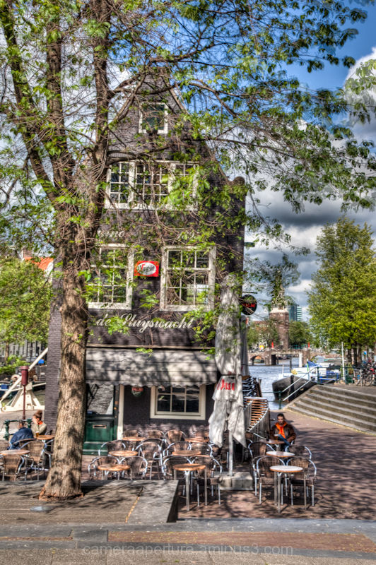 a leaning cafe in the city of Amsterdam