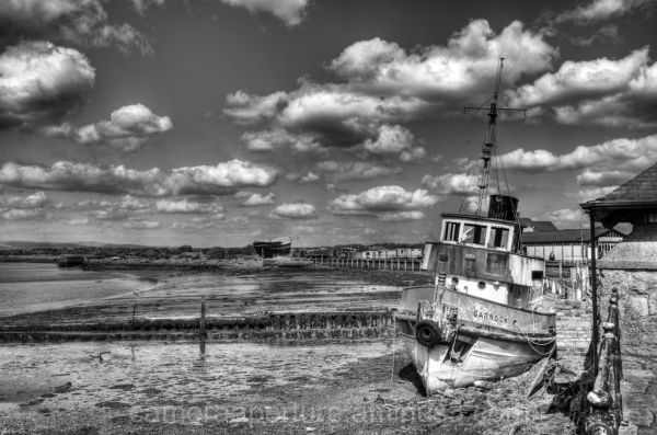 A boat high and dry waiting on the tide to come in