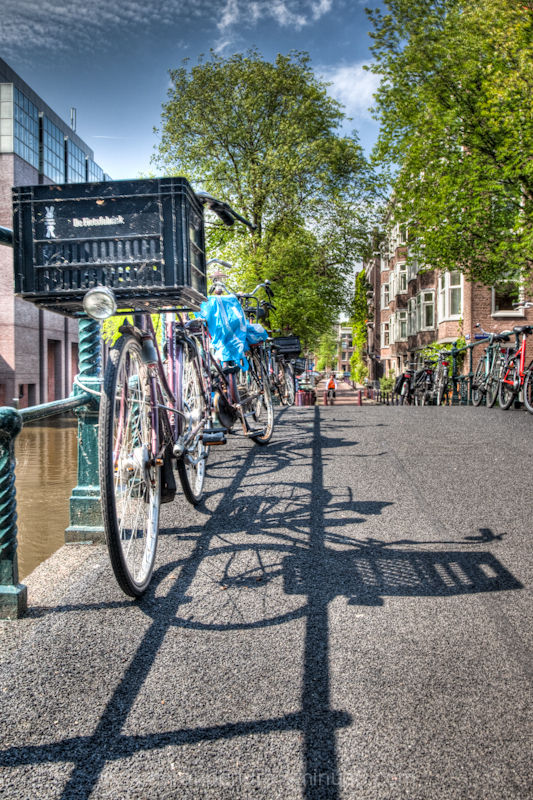 The shadow of a bike on an Amsterdam pavement