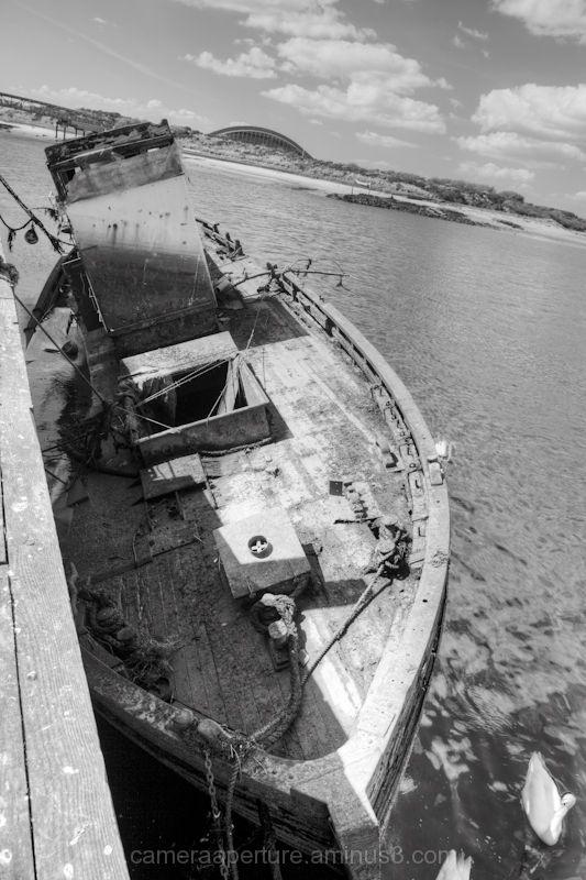A sunken boat at low tide