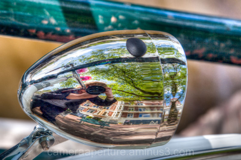 A reflection on a bike lamp, in Amsterdam