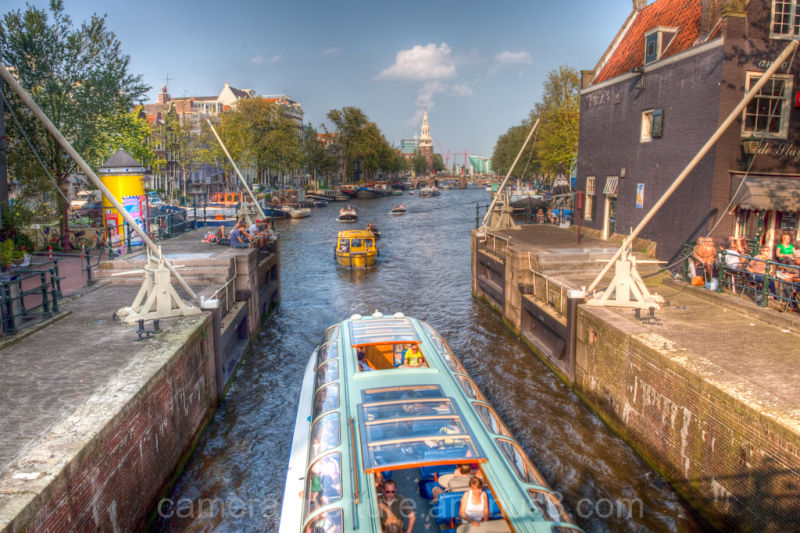 A Tourist boat in an Amsterdam canal lock