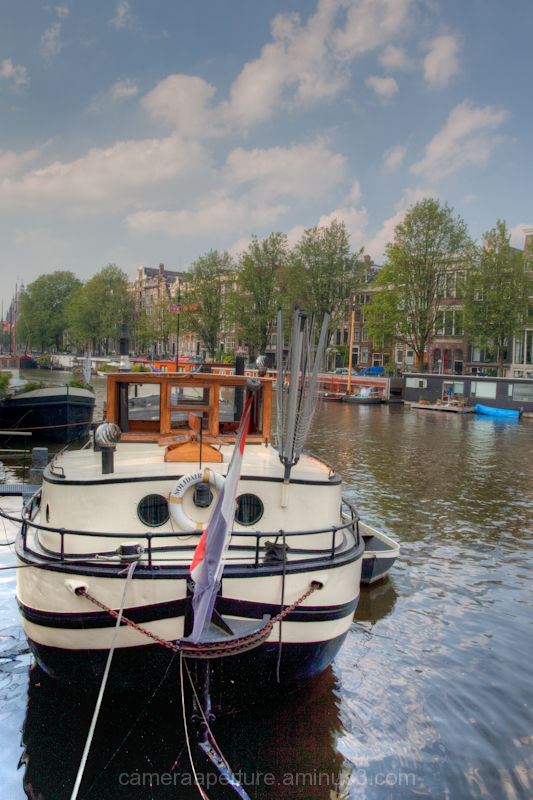 A house boat on the canal in the city of Amsterdam