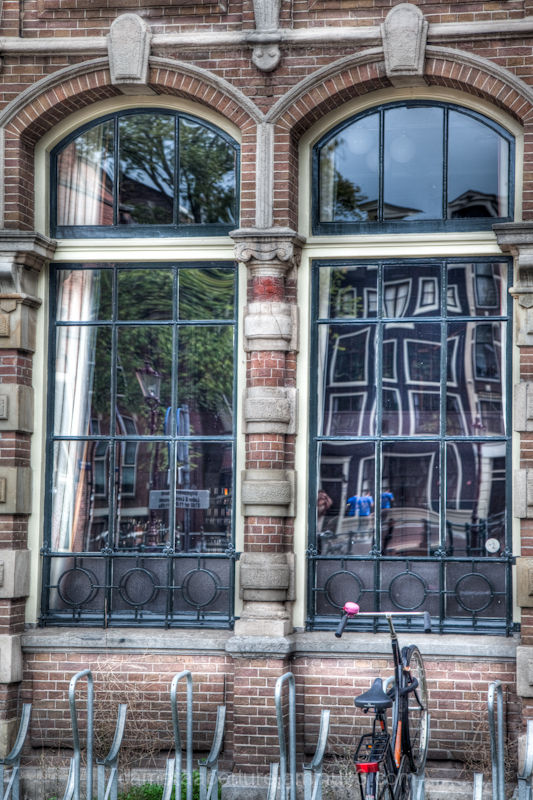 The reflects in the glass of Amsterdam windows