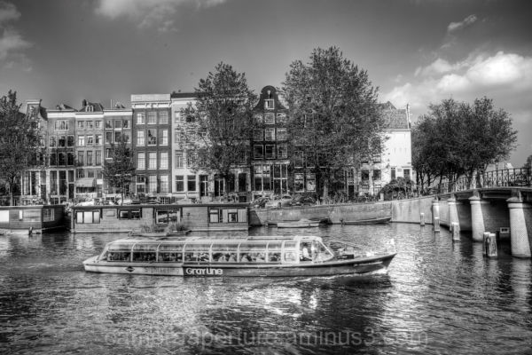 A tourist boat on an Amsterdam canal