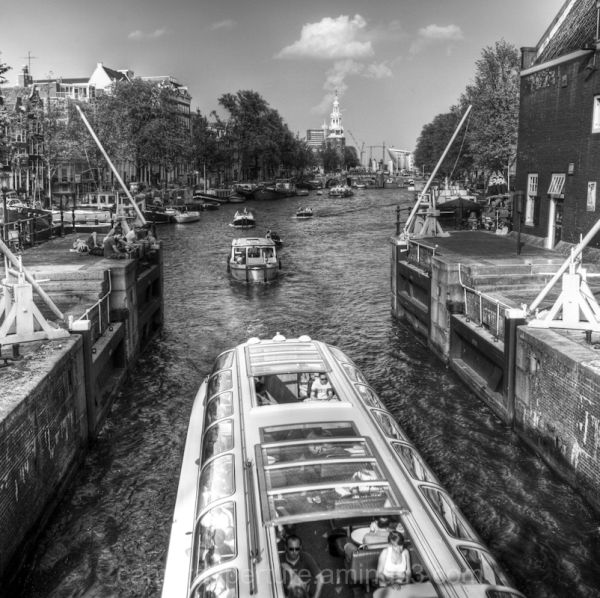A tourist boat in an Amsterdam lock.