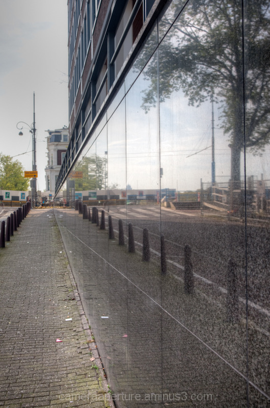 A reflection on a building wall in  Amsterdam