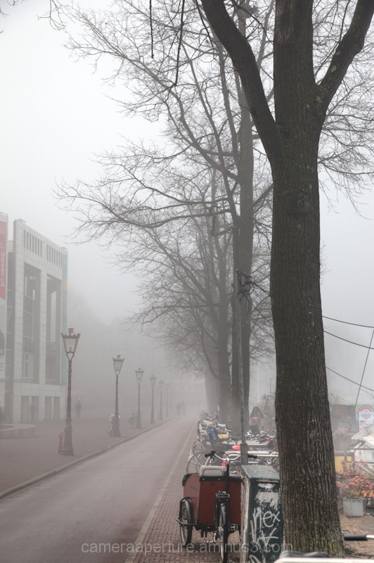 The city of Amsterdam on a misty day