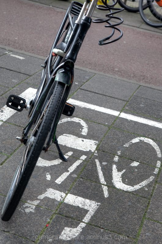 A sign to where to park your bike in amsterdam