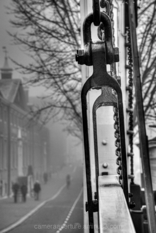 A bridge in the mist, in the city of Amsterdam