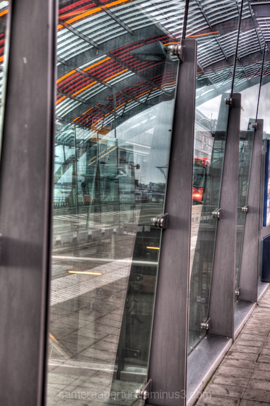 A glass barrier at the bus station in CS Amsterdam