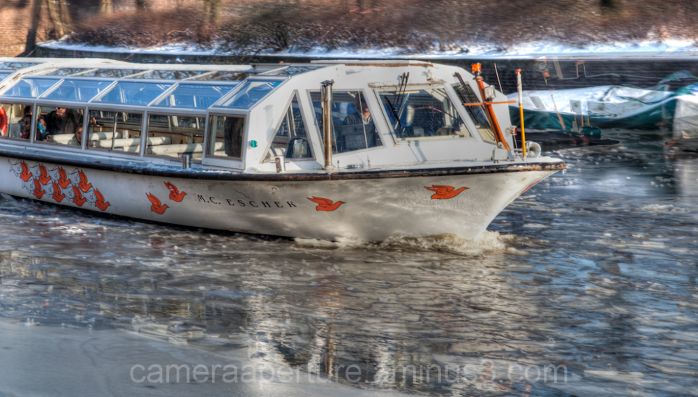 A tourist boat in the ice on an Amsterdam canal