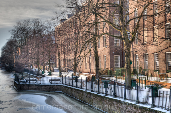 A frozen canal side in the city of Amsterdam