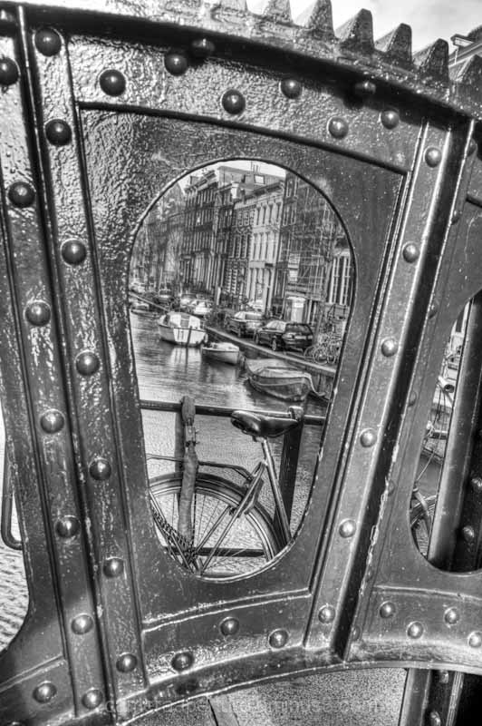 A view through a bridge in the city of Amsterdam