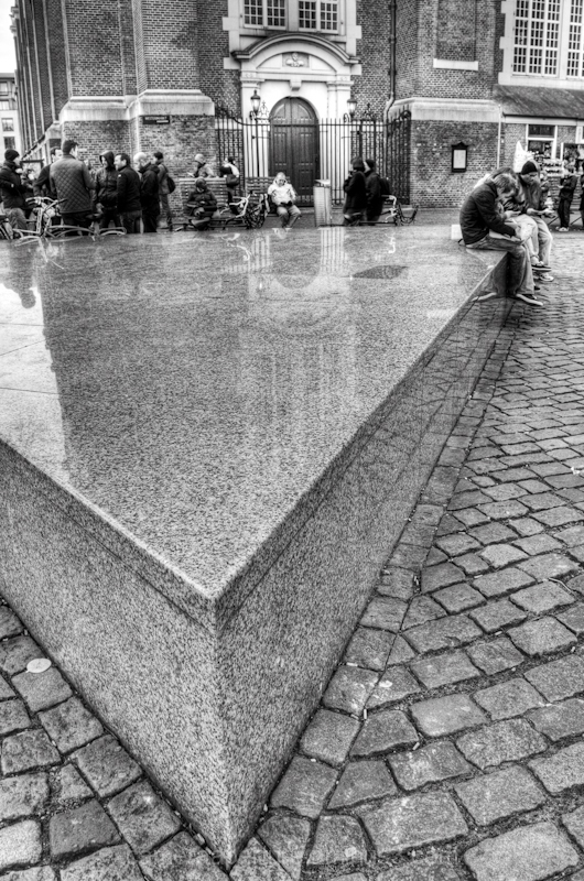 A Stone triangle seat in the city of Amsterdam