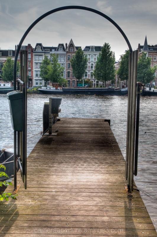 A doorway view of the river Amstel in Amsterdam