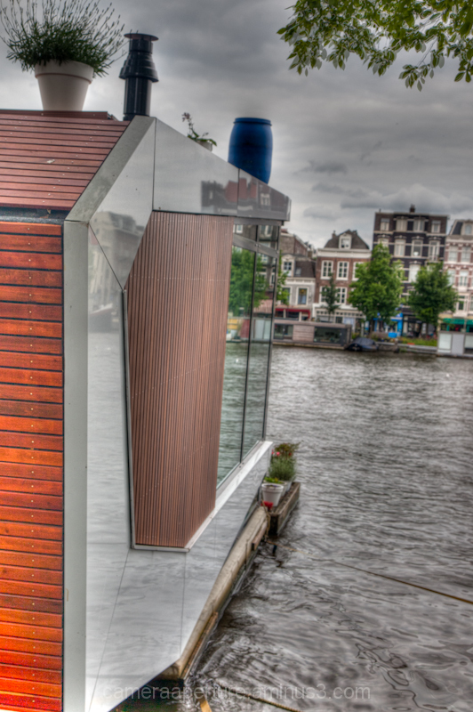 The side of house boat on the Amstel river