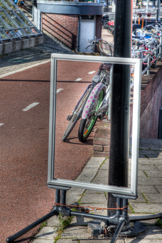 A view of bike lane through empty frame amsterdam