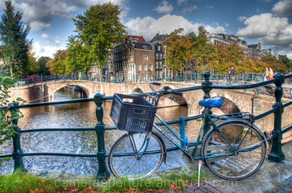 A bike on a canal in the city of Amsterdam
