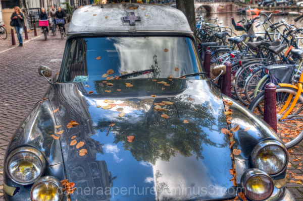 A vintage car in the city of Amsterdam