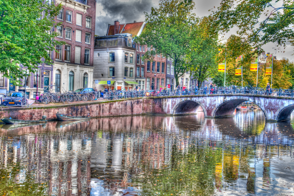 Reflection of bridge in the canal in amsterdam