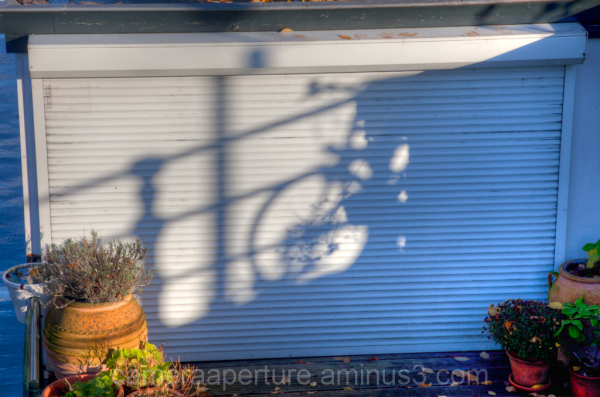 A bike shadow on the wall of house boat