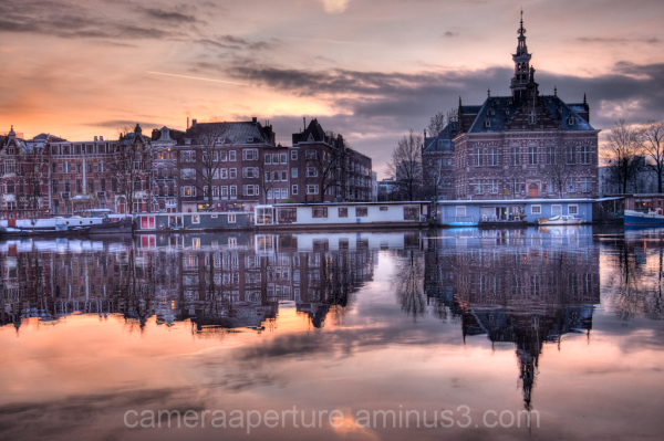The Amstel river at dusk, in amsterdam