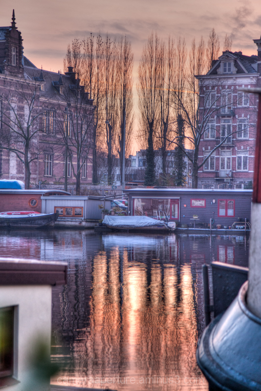 Twilight reflection on the Amstel river Amsterdam