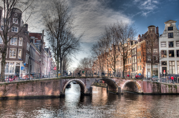 A bridge over a canal in the city of Amsterdam