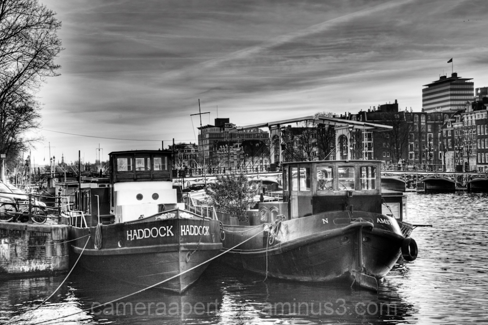 Boats on the Amstel river in the city of Amsterdam