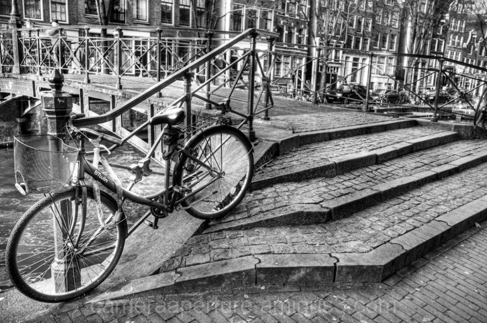 Stairs of a footbridge over an Amsterdam canal