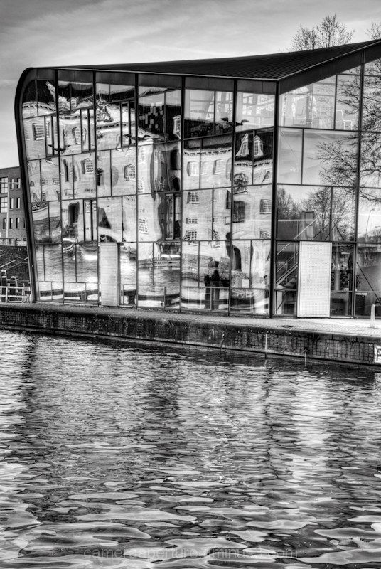 A reflection of a building in glass amsterdam