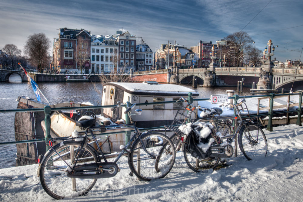 Bikes in the snow in the city of Amsterdam