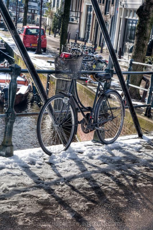 Bike on the bridge in the city of Amsterdam