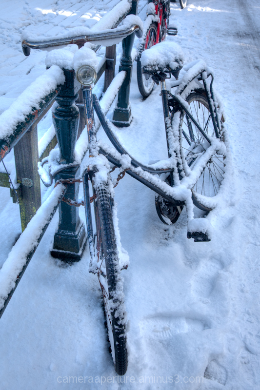 Bike in the snow in the city of Amsterdam