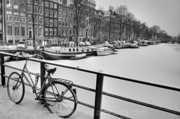 a bike on an Amsterdam canal