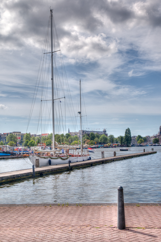 A white sailing ship in the city of Amsterdam