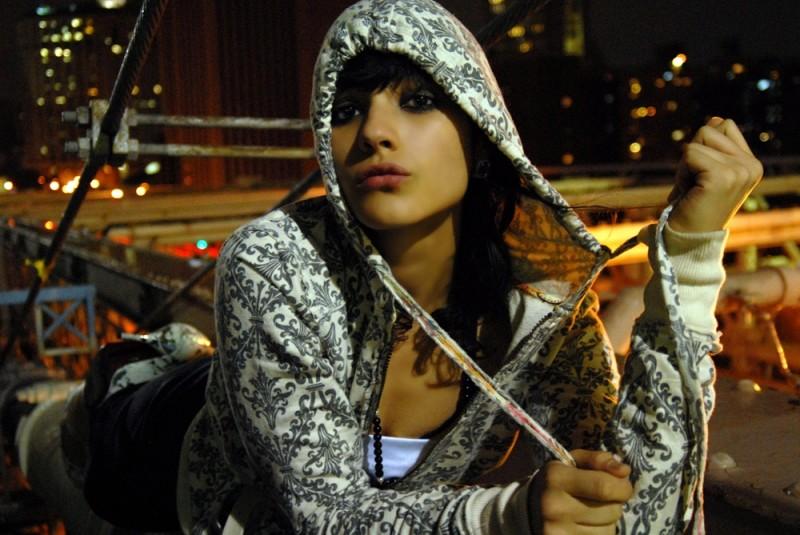 Meagan Cignoli model hanging off brooklyn bridge