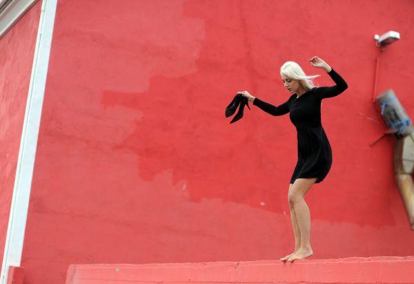 Girl on a ledge by Meagan Cignoli fashion photog