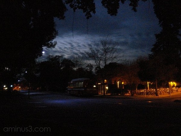 bus stop at night bikes