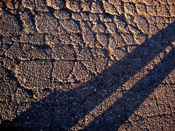 asphalt cement gravel rocks shadow self-portrait