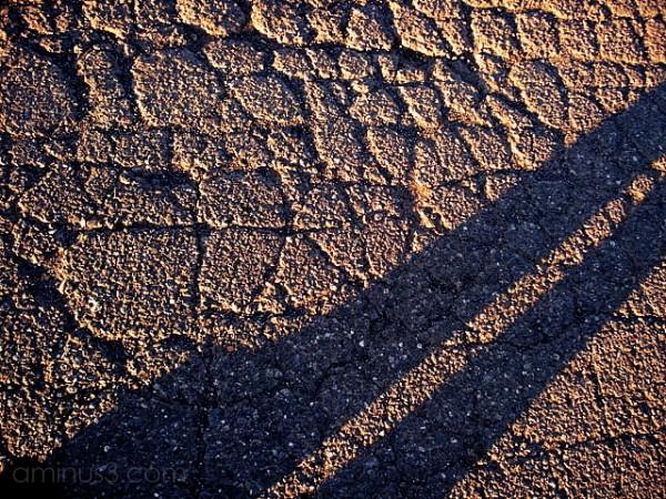 asphalt cement gravel rocks shadow self-portrait