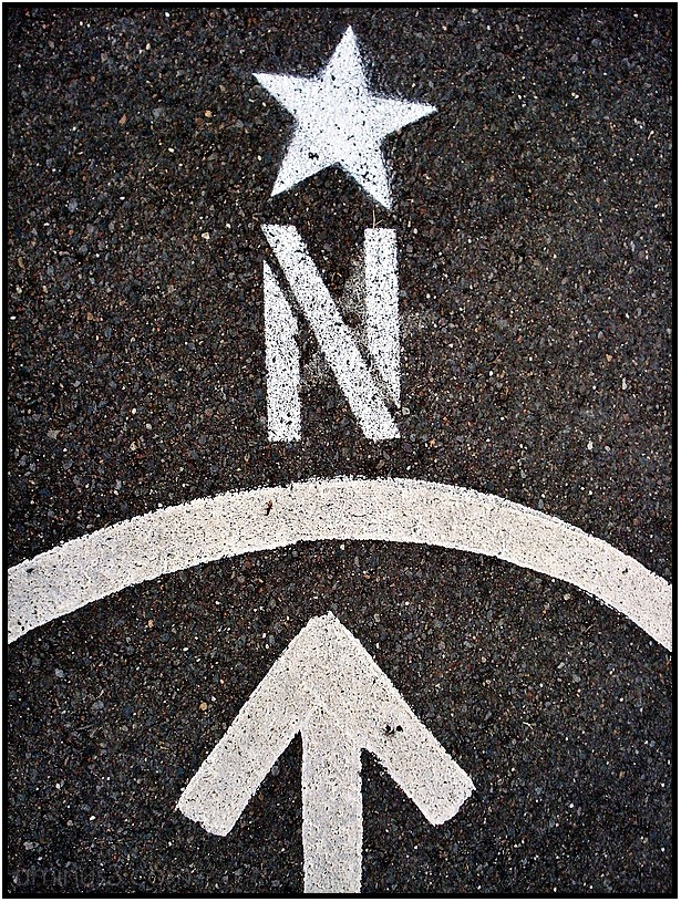 compass north arrow asphalt paint sign