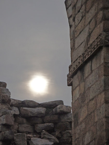 untitled sun behind ruins