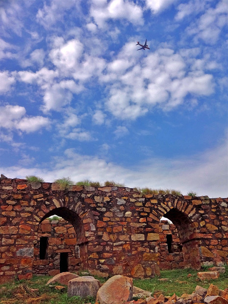 untitled plane over ancient ruins