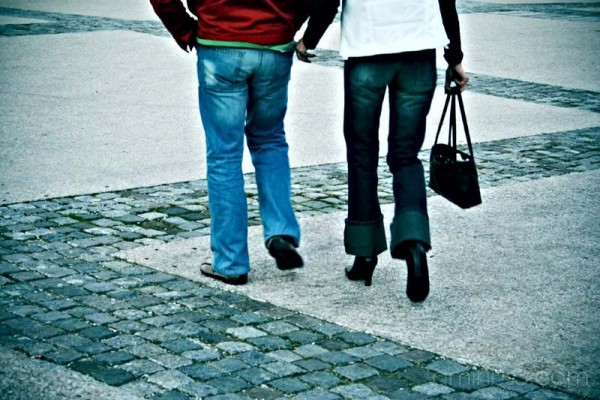 two people walking on the street