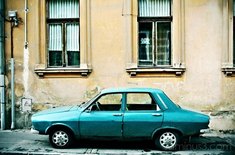old car (renault) parked on the sidewalk