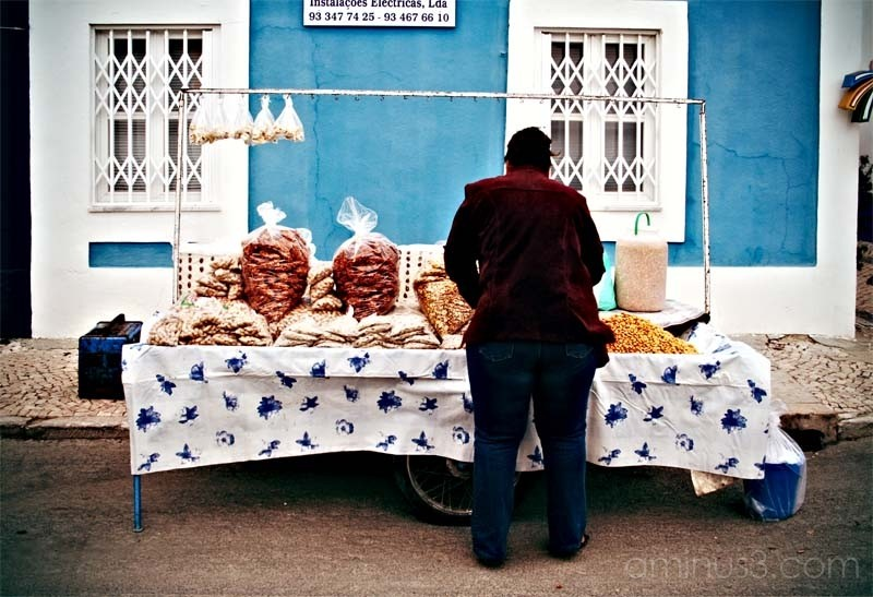 woman in the street selling fruit