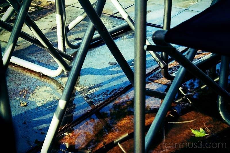 chairs legs on the sidewalk